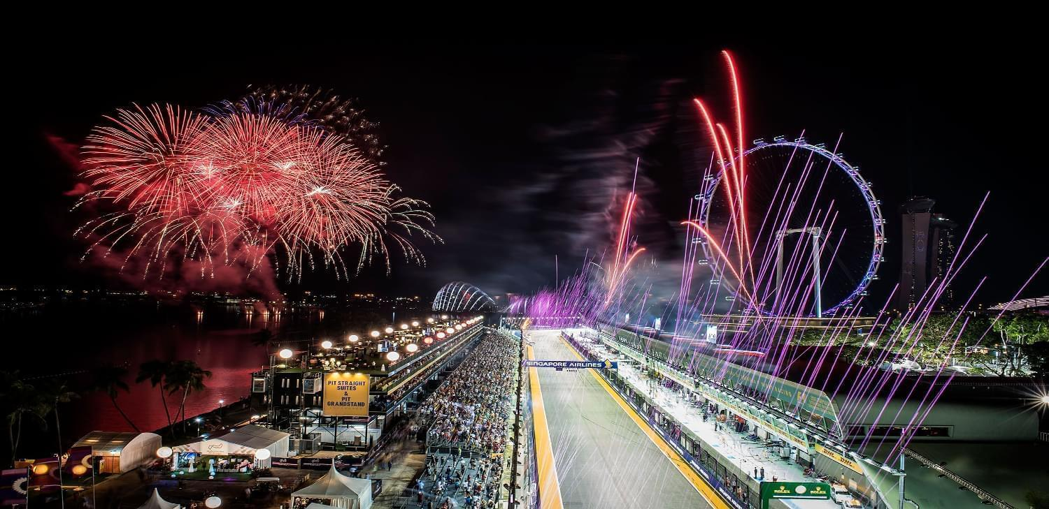 Spectacular fireworks light up the night sky after the chequered flag is waved
