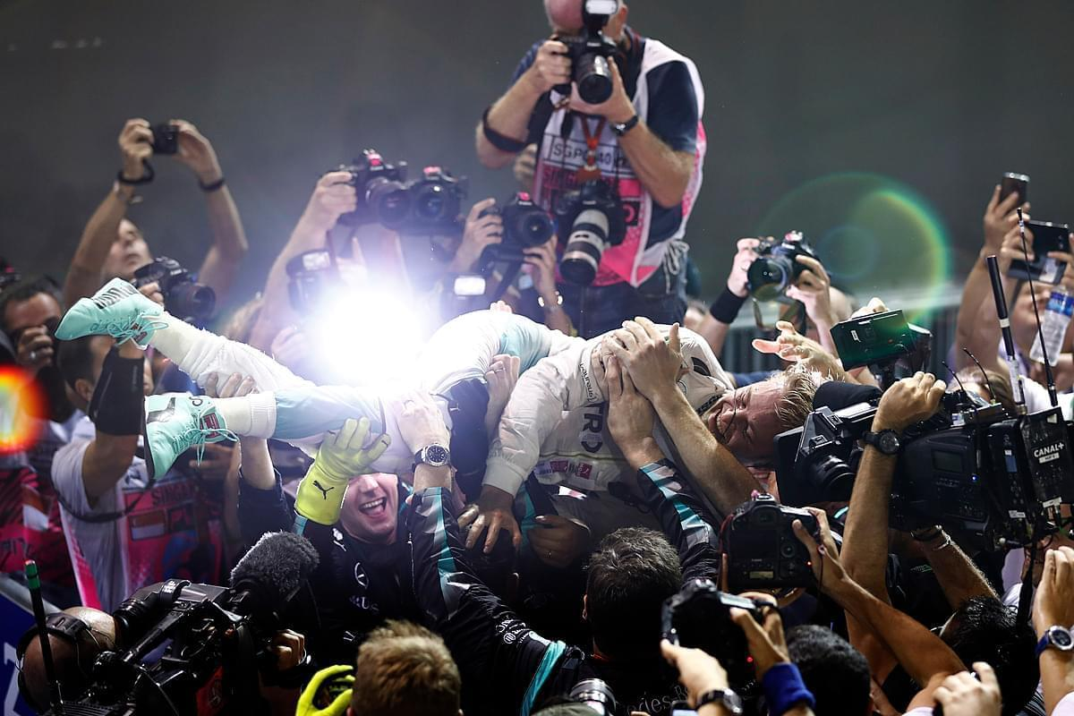 Nico Rosberg, Mercedes AMG celebrates with his team after winning the race.